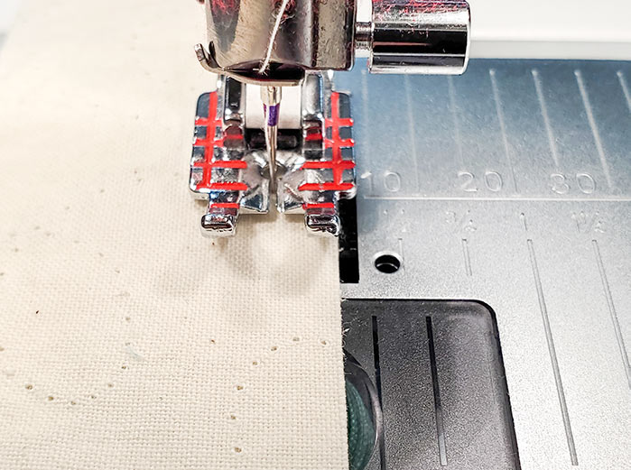 "Using the Quilter's ¼"" Piecing Foot to sew a ¼"" seam on the Husqvarna Viking Brilliance 75Q sewing machine"
