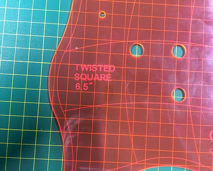 Always make sure that you can always read the name of the Twisted Square Template when you are rotary cutting, to make sure that you are always cutting the blocks in the same orientation.