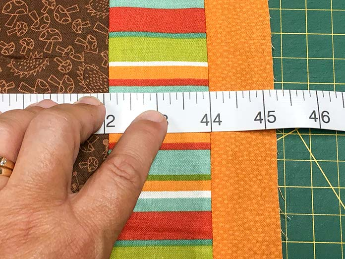 : Use a Unique Sewing tape measure to measure the width of the quilt along the top and bottom and through the middle.