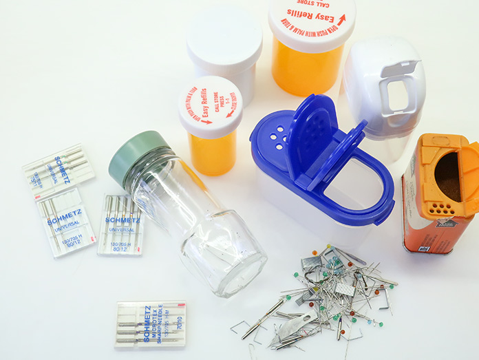 Used or broken pins, needles, blades and other sharp metal objects ready to be safely stored in various containers.