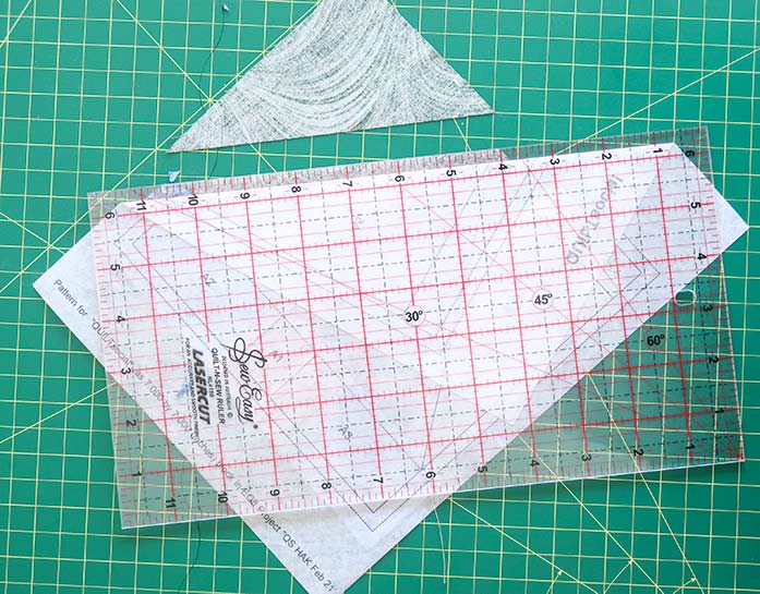 """For a perfect edge along which to align the next fabric, trim ¼"""" away from the fold. Using UNIQUE Quilt Template - 21 x 30cm [8¼"""" x 11¾""""], UNIQUE SEWING Quilt Template with Grid - 21 x 28.5cm [8¼"""" x 11""""], Gütermann threads, UNIQUE Dye Catcher and StitchnSew sheets."""