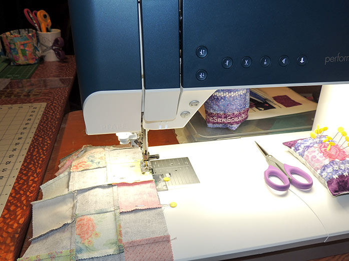 Sewing a long border to the nine-patch strip. PFAFF performance icon