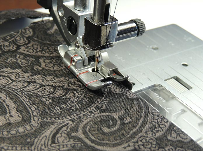 Sew neat hem lines using the ¼ inch Right Guide Foot for IDT System and matching thread. PFAFF performance icon