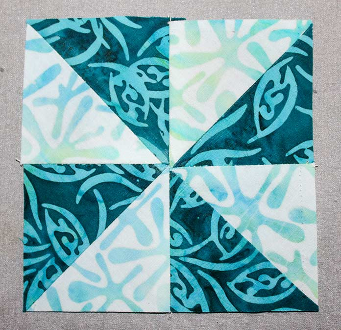 """Stitch 2 rectangles from step 2 together to make a 4 ½"""" square"""