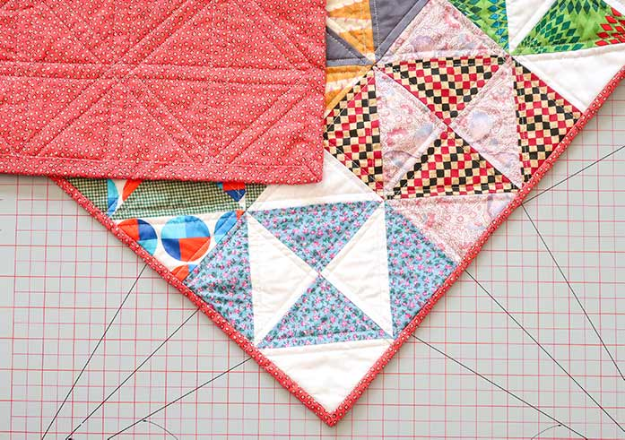 Showing the binding of a quilt's front and back