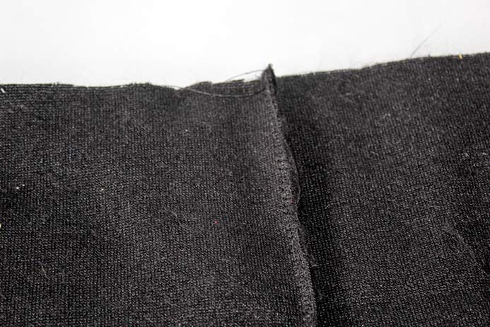 The back side of the Fabric Creations Faux Fur shown with a wide zigzag stitch at the seam.