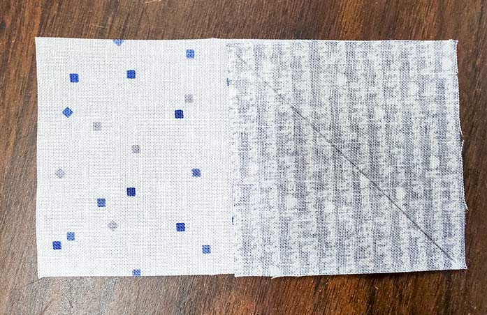 A fabric square positioned on a rectangle of fabric