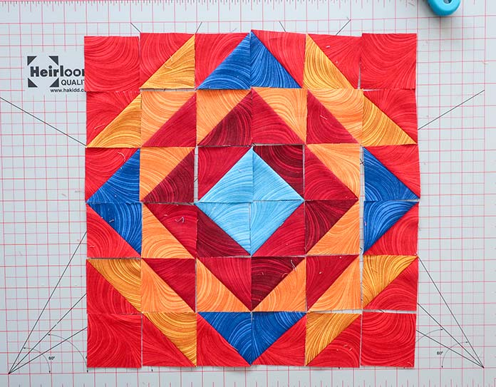 Laying out the fabric pieces according to the block's layout diagram first will make it easier to sew the block's pieces together. Block 3 Spectrum QAL 2020 quilt design featuring fabrics from the Wave Texture collection by Benartex.