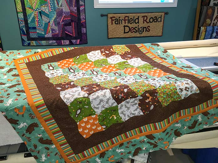 The quilt top made using Forest Friends fabrics by Fabric Creations is ready to quilt.