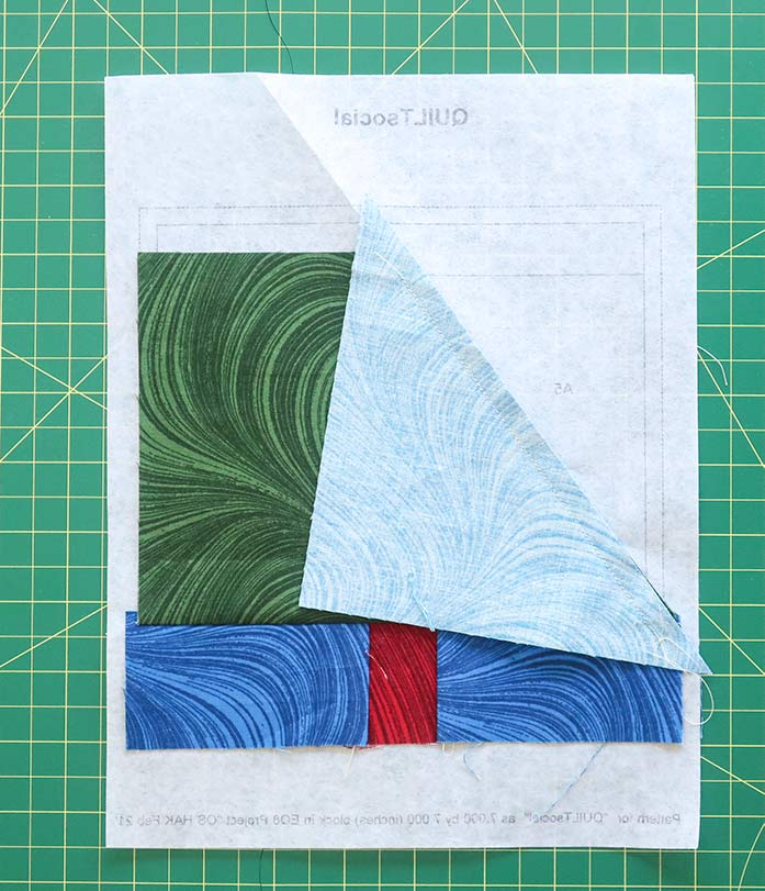 """Place the A5 fabric piece along the A4 fabric edge before sewing. Using UNIQUE Quilt Template - 21 x 30cm [8¼"""" x 11¾""""], UNIQUE SEWING Quilt Template with Grid - 21 x 28.5cm [8¼"""" x 11""""], Gütermann threads, UNIQUE Dye Catcher and StitchnSew sheets."""