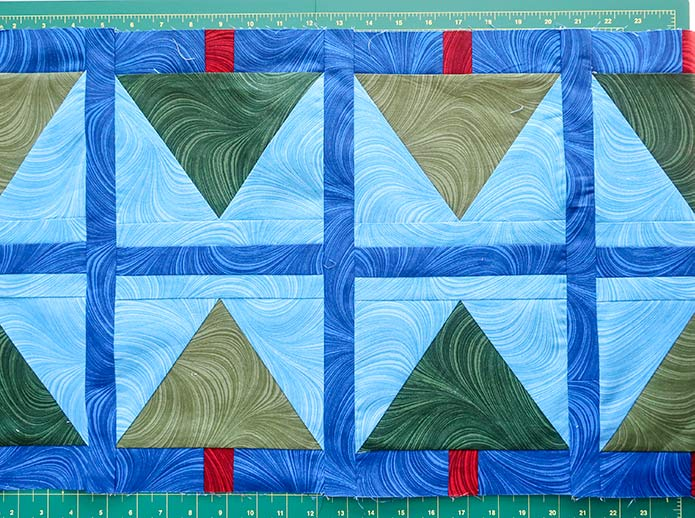 """To frame each block, add a 1½"""" x 15½"""" strip between each pair of blocks as well as at each end of the table runner. UNIQUE sewing and quilting template sheets, HEATNBOND Stitch n Sew EZ Print Quilt Block Sheets, UNIQUE folding cutting mat, SEW EASY Quilting Ruler"""