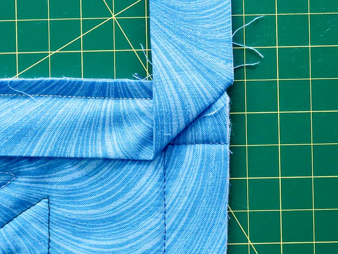 The sewn strip is folded away from the quilt. Gütermann threads