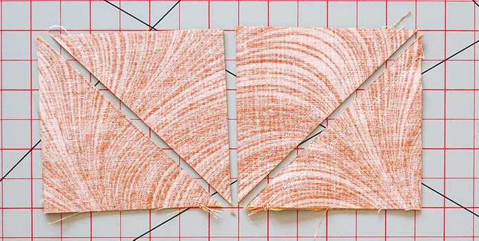 Fabric piece D is cut along the diagonal and vertical lines after sewing to make four sets of half- square triangles.