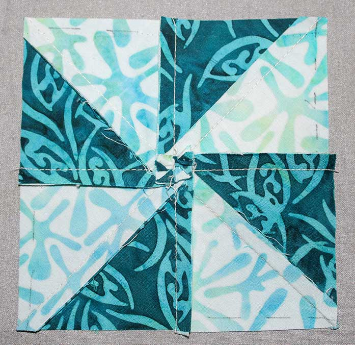 Press the seams to create a mini pinwheel on the back of the block to reduce bulkiness