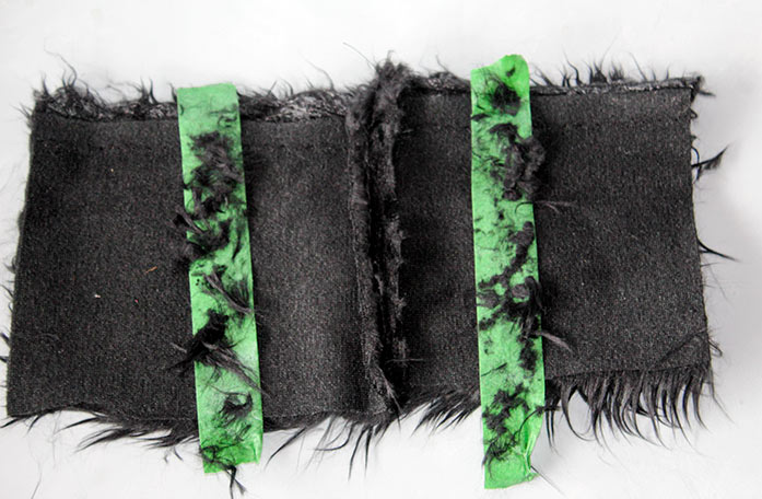 The reverse side of the Fabric Creations Faux Fur showing a straight stitched seam with a seam allowance.