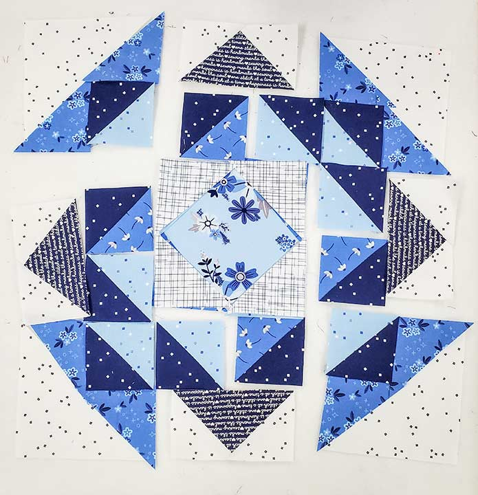 Blue and white fabric squares for Block 3 featuring the Blue Stitch collection by Riley Blake Designs.