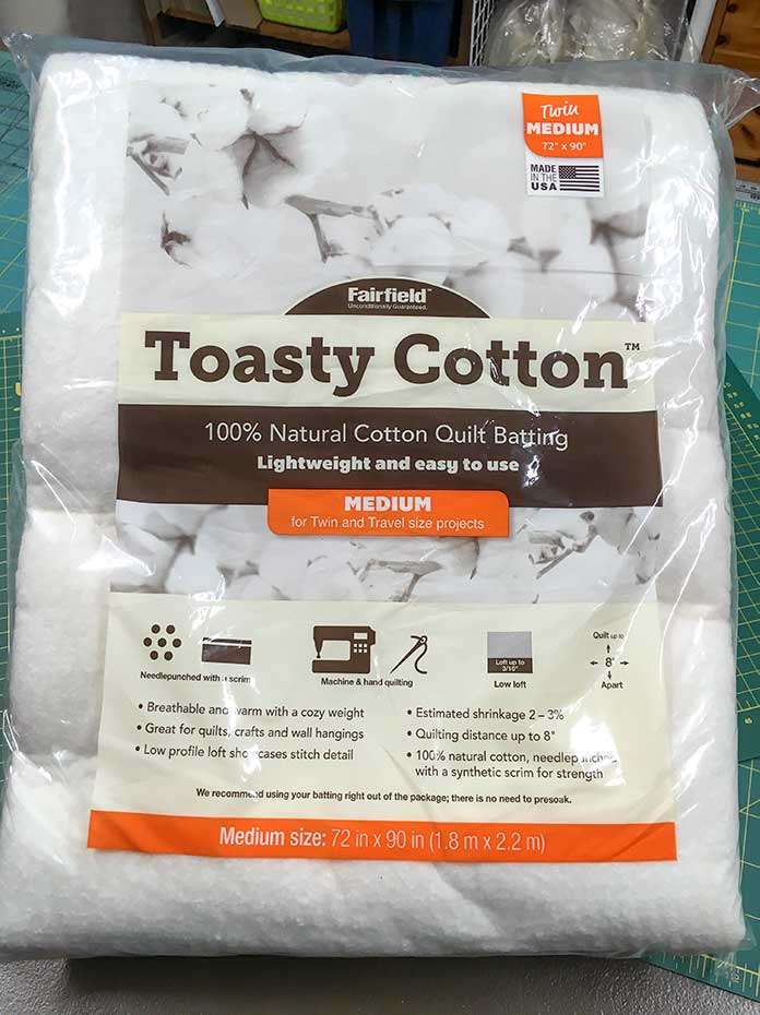 A medium size package of Toasty Cotton Natural Cotton Quilt Batting by Fairfield.