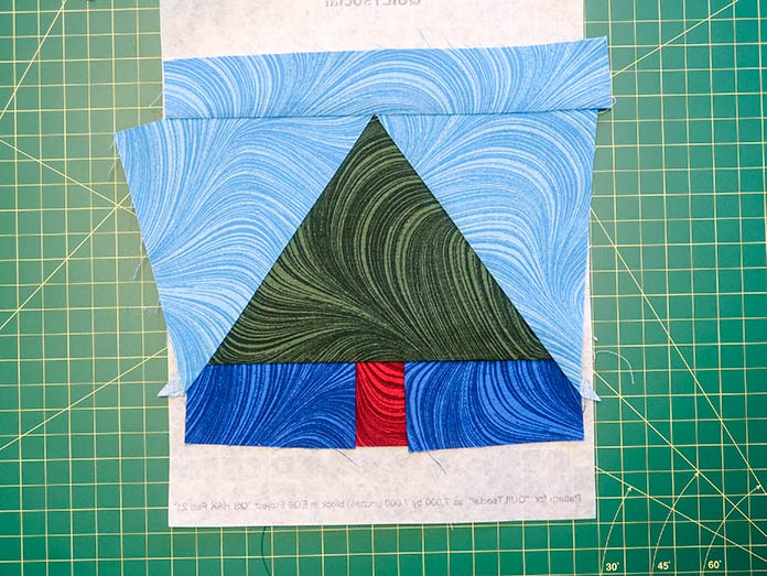 """The foundation-pieced tree block assembled and ready for trimming. Using UNIQUE Quilt Template - 21 x 30cm [8¼"""" x 11¾""""], UNIQUE SEWING Quilt Template with Grid - 21 x 28.5cm [8¼"""" x 11""""], Gütermann threads, UNIQUE Dye Catcher and StitchnSew sheets."""