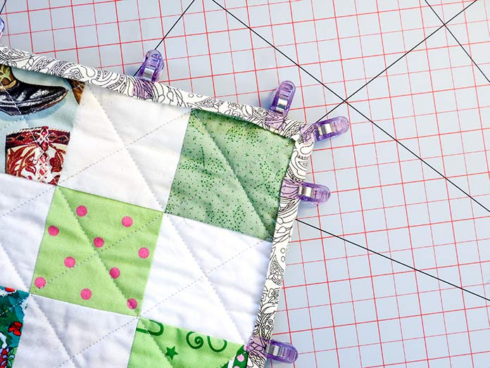 Use Clever Clips along the quilt's edges to keep the binding in place before sewing