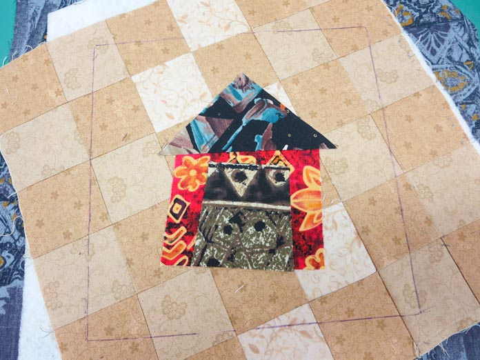 """Layers are basted together in preparation for quilting. Brother Innov-ís BQ3050 sewing and quilting machine, Mary Ellen's Best Press, Brother SA185 ¼"""" Piecing Foot with Guide, Brother SA125 ¼"""" Quilting Foot, Olfa square ruler, MuVit digital dual feed foot"""
