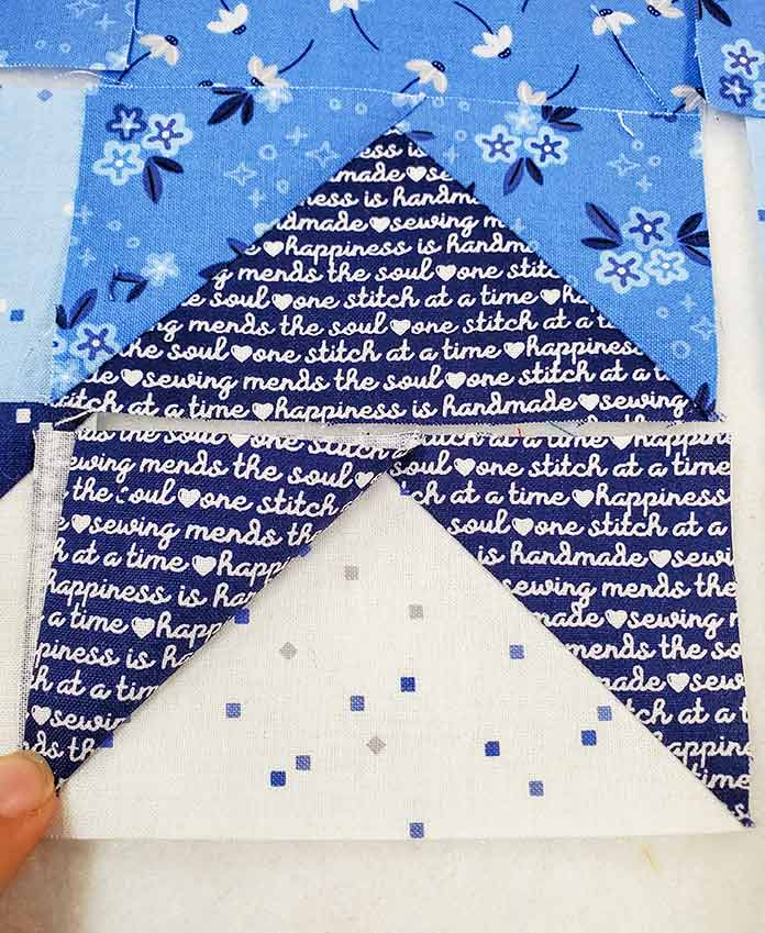 A rectangle of light blue fabric with two triangles of dark blue fabric