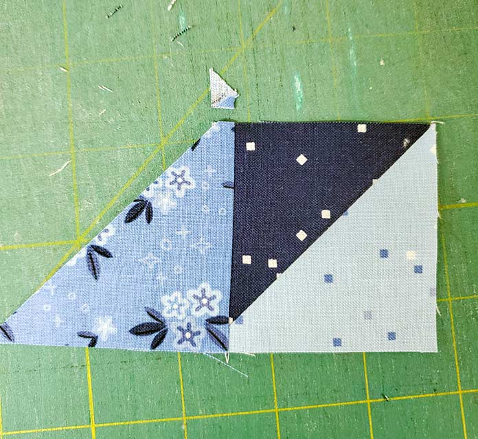 A triangle and a square of blue fabric