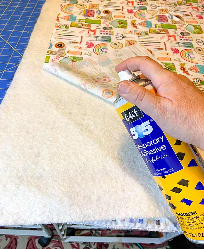 Three layers of the sewing machine mat basted together with Odif 505 Temporary Quilt Basting Adhesive Fabric Spray.