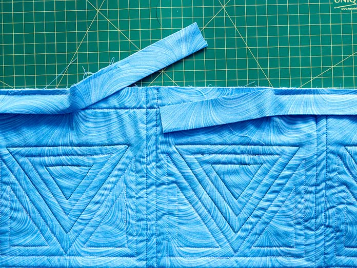 """Ending the seam 8"""" - 12"""" away from the starting point will make it easier to join both ends of the binding strip together. Gütermann threads"""