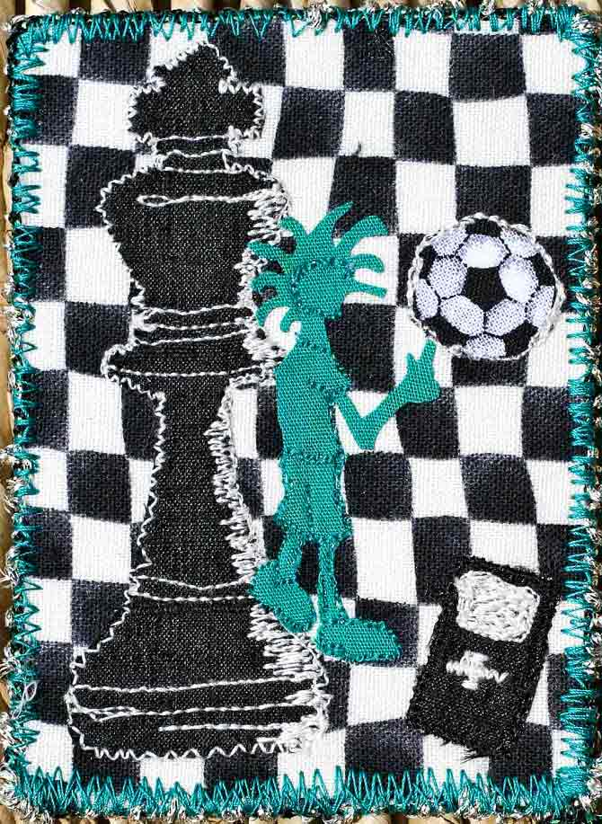 This quilted artist trading card was created for a teenage boy who excelled at the game of chess and loved to play soccer. Created by Debbie Bates.