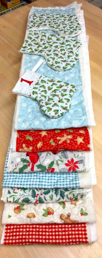 Quilt sandwiches completed and ready to make 24 mini stockings with Northcott Holiday Collections, Sugar and Spice, Swedish Christmas & Fairfield Quilter's 80/20 Quilt Batting