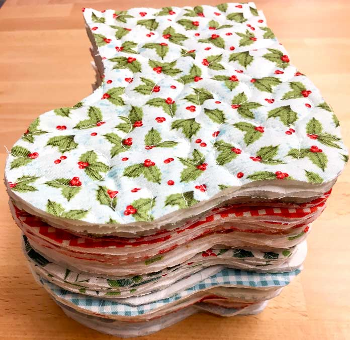The stack of stocking (front and backs) you should have at this stage with Northcott Sugar and Spice and Swedish Christmas Holiday Collections fabric