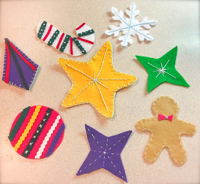 Holiday shapes cut from Kunin Rainbow ClassicFelt and PrestoFelt, embellished with DMC Embroidery Floss, Heirloom Quality Crewel Embroidery Needles and hand embroidery stitches