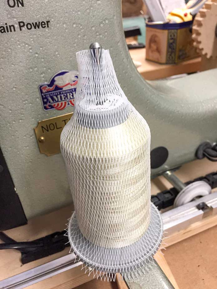 UNIQUE longarm thread cone net cut. Hard to see but thread is fed from top of thread net.