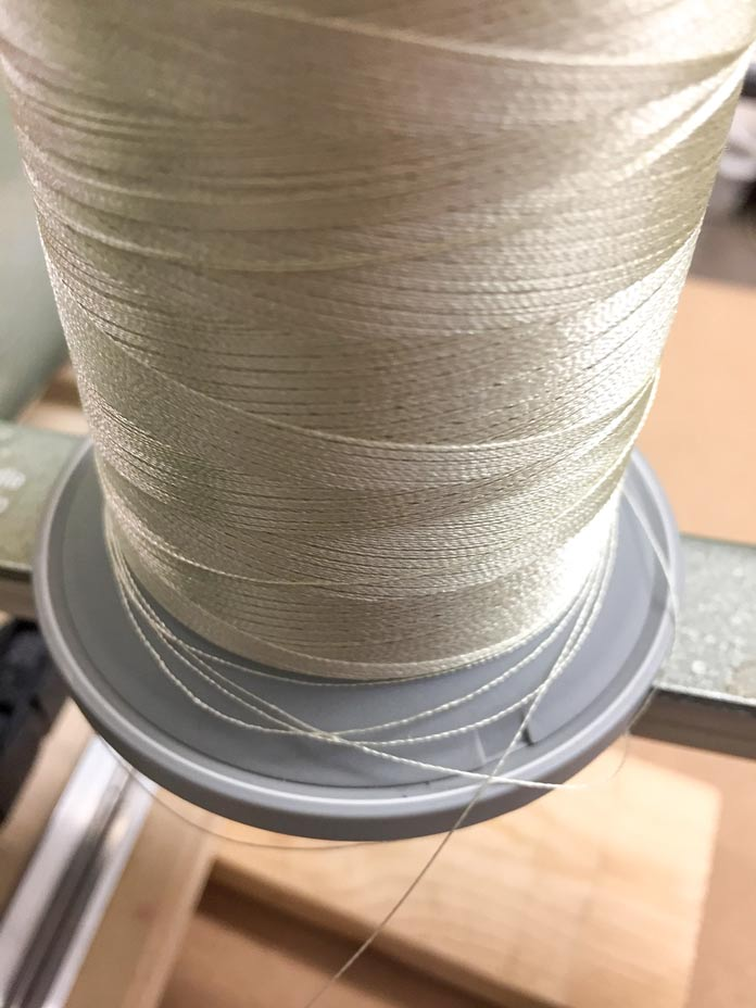 Example of thread pooling at the bottom of the spool, this can cause tension issues, thread and needle breakage.