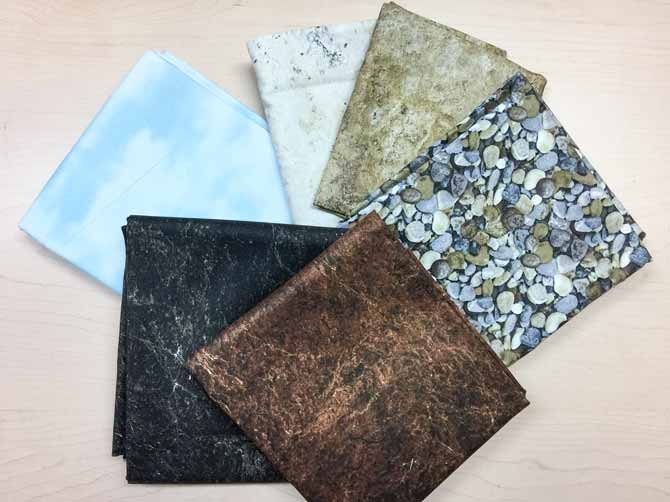Northcott's stunning Naturescapes fabric collection folded laying on a table