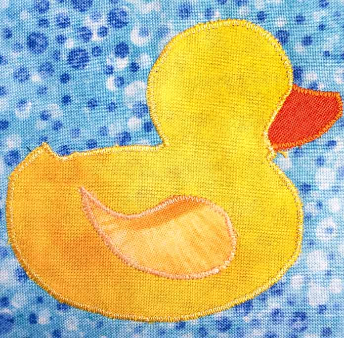 Satin stitched duck applique for baby bib