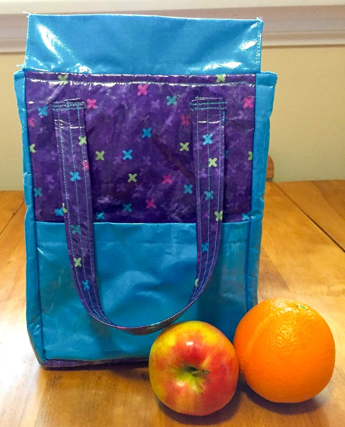 HeatnBond Iron-on Vinyl laminated lunch bag, fabric is X's and O's Wild Orchid, Northcott Studio by Deborah Edwards & Northcott Colorworks