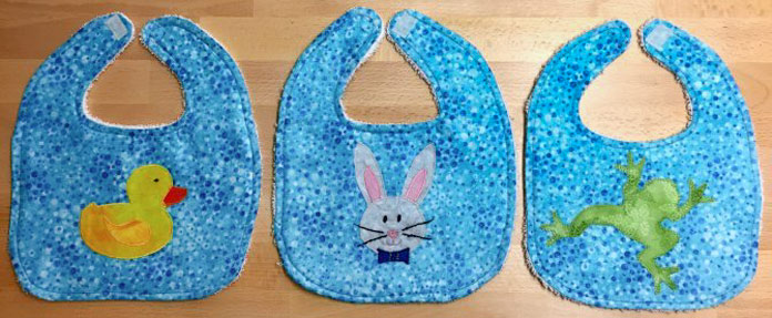Bibs made 'cute' with applique using HeatnBond Feather Lite