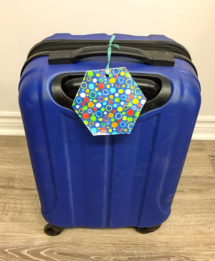 Use your left over bits of HeatnBond Iron-on Vinyl and fabric for luggage identifying tags. Fabric X's and O's By Deborah Edwards, Northcott Studio