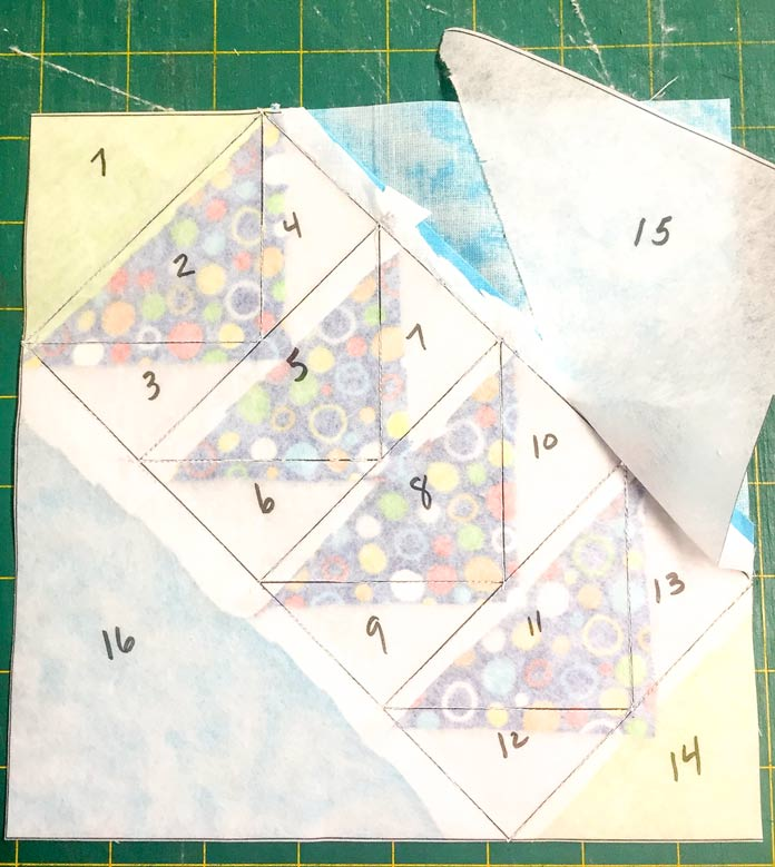 Tear away the StitchnSew EZ Print Quilt Block Sheets