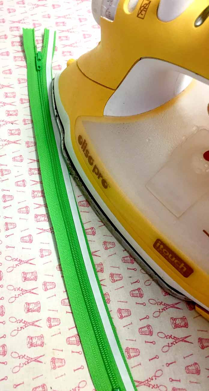 Add HeatnBond Quilter's Edge to the right side of your zipper to iron baste it to your project.