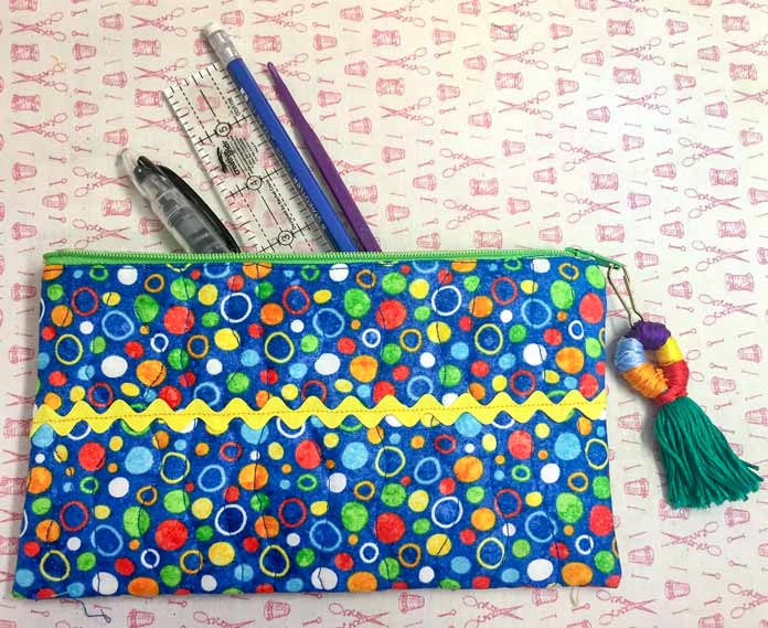 Pencil case made with HeatnBond Quilter's Edge to baste the zipper and the rick rack.