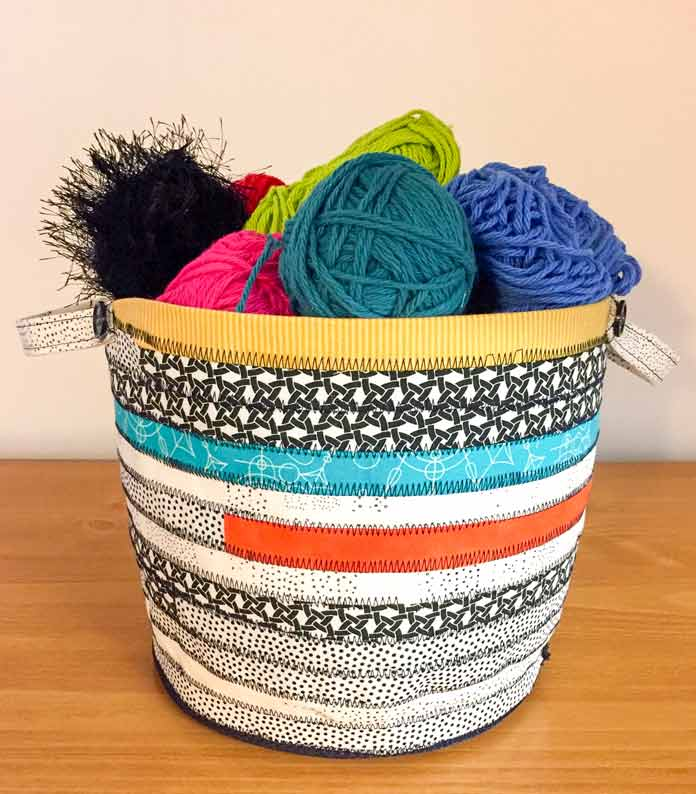 Finishing a craft basket with Sulky Fuse 'n Stitch for stability