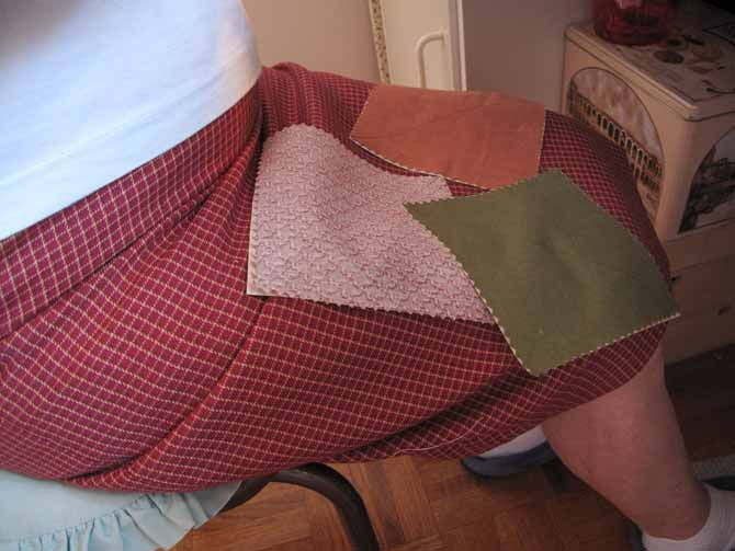 fabric charm squares on a lap to make half square triangles for a quilt