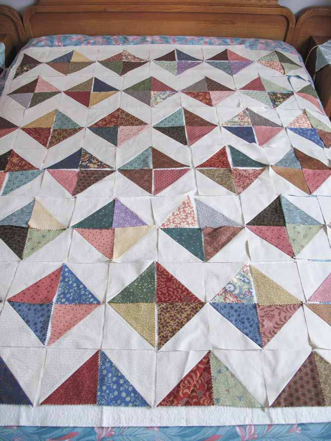Half Squre Triangle blocks design creating a zigzag pattern for a quilt top