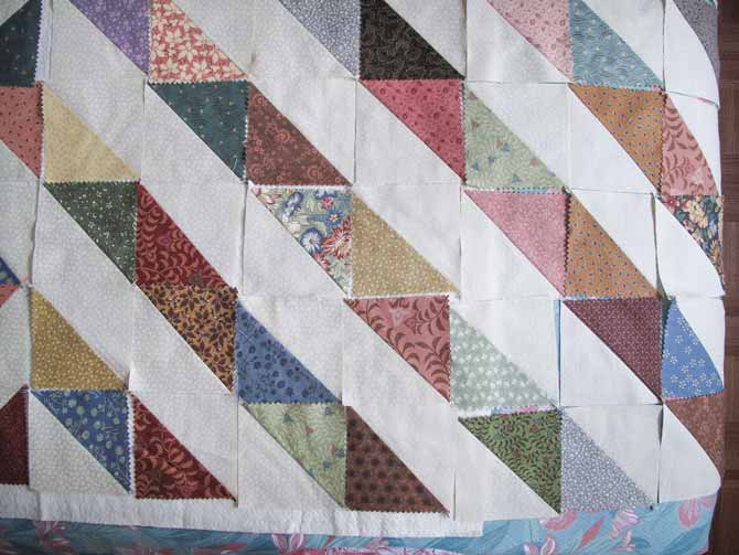 fabric arranged in half squared triangle blocks to make a quilt top design