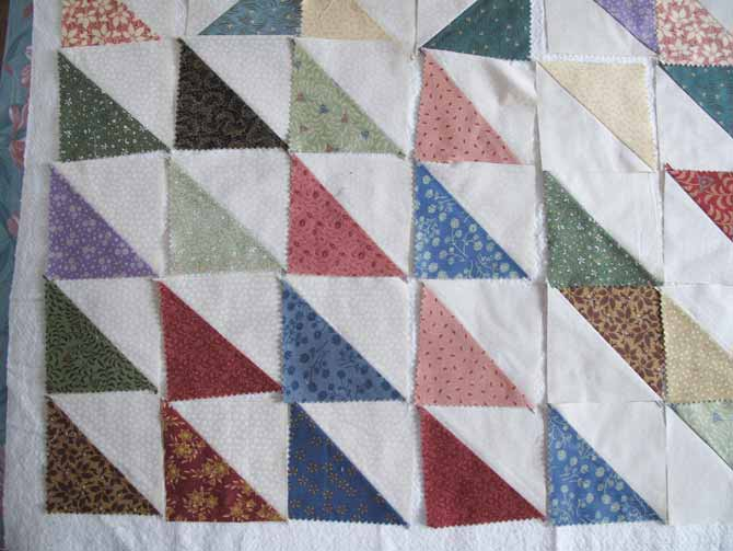 fabric in Half Square Triangle blocks design for a quilt top - one of my favorites and a strong candidate for a featured quilt on QUILTsocial.com - stay tuned!
