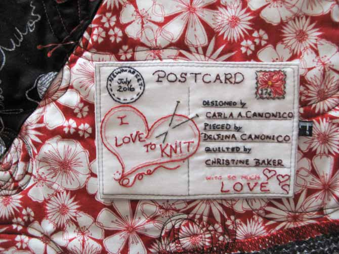 The finished quilt label on the floral fabric of the I Love to Knit quilt - a little too busy