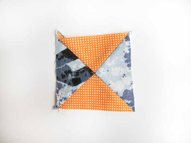 Using scrap fabric I made my first Quarter Square Triangle. The points match up but the top of the square is a little...off.