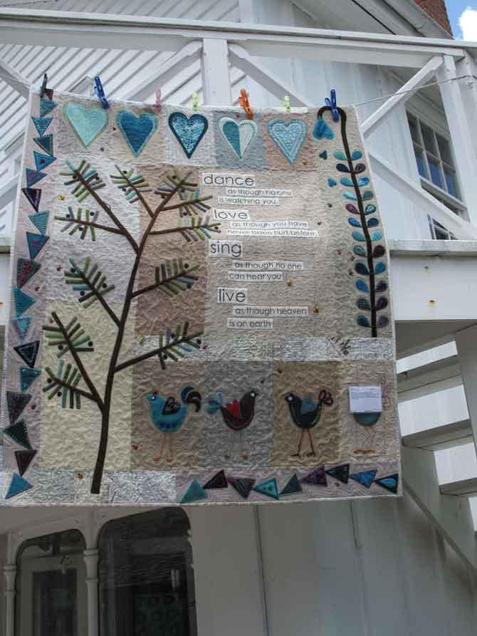 Cotton and wool quilt. The applique is done using felted wool on a cotton background. Express yourself whenever possible on your quilt!